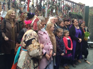Women gather outside the Crossbones Graveyard